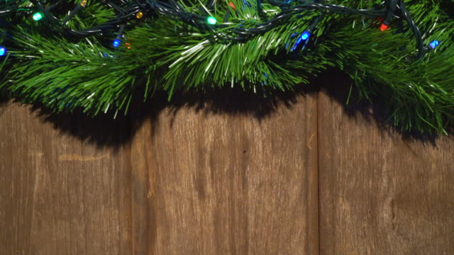 Light for christmas tree Santa hat and happy new year, copy space, top view, 4k 30fps resolution. Light for christmas tree Santa hat and happy new year, copy space, top view, 4k 30fps resolution. plank timber stock videos & royalty-free footage