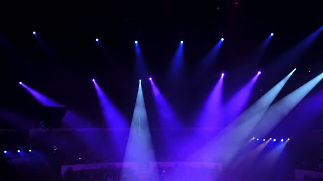 Light from the scene during the concert in a circus