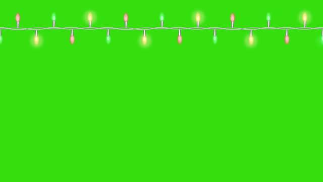 leichte girlande mit blinkenden lichtern. loop footage 4k mit alpha cannel - girlande dekoration stock-videos und b-roll-filmmaterial