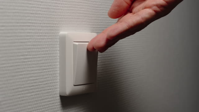 Light is Off - Human hand switch off a power button on a wall video