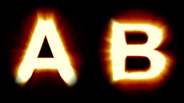 leichte buchstaben a und b - warmes orange licht - flackern schimmernde animationsschleife - isoliert - dekorative kunst stock-videos und b-roll-filmmaterial