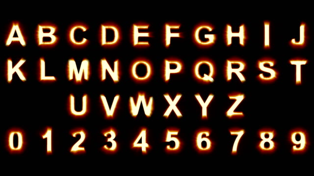 light letters and numbers - warm orange lights - flickering shimmering animation loop - grid for precise selection included - isolated video