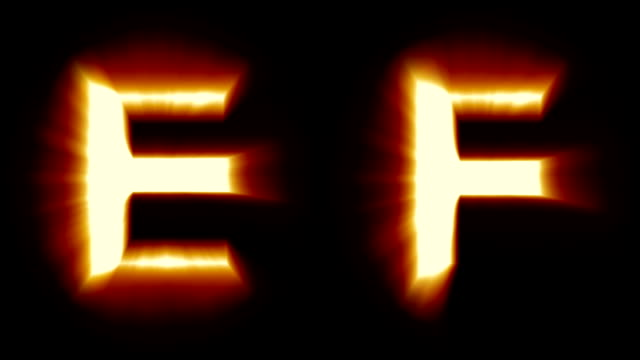 light letters E and F - warm orange light - flickering shimmering animation loop - isolated video