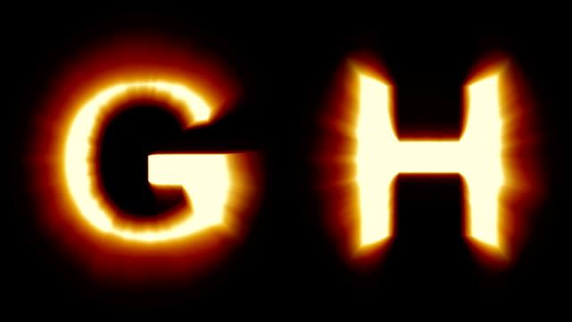 leichte buchstaben g und h - warmes orange licht - flackern schimmernde animationsschleife - isoliert - dekorative kunst stock-videos und b-roll-filmmaterial