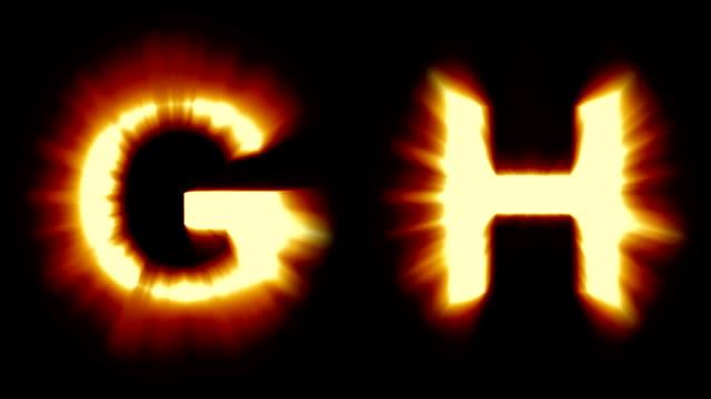 leichte buchstaben g und h - warmes orange licht - starke schimmernd und flackernde animationsschleife - isoliert - dekorative kunst stock-videos und b-roll-filmmaterial