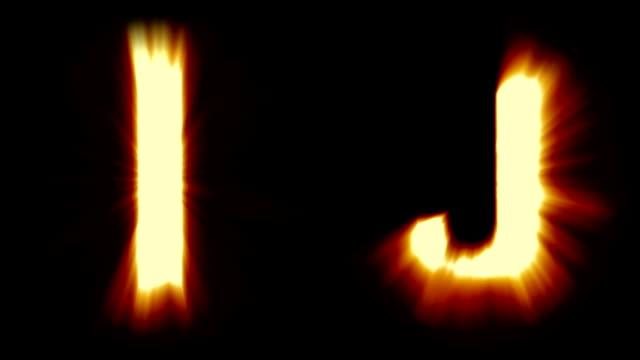 licht buchstaben i und j - warmes orange licht - starke schimmernd und intensive flackernde animationsschleife - isoliert - dekorative kunst stock-videos und b-roll-filmmaterial