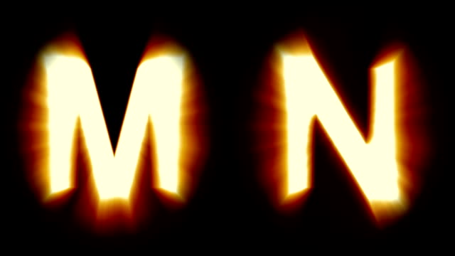 light letters M and N - warm orange light - flickering shimmering animation loop - isolated