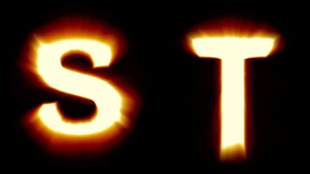light letters S and T - warm orange light - flickering shimmering animation loop - isolated video