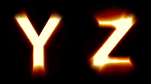 light letters Y and Z - warm orange light - flickering shimmering animation loop - isolated video