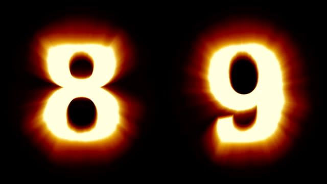 licht, nummern 8 und 9 - warmes orange licht - flackern schimmernden animationsschleife - isoliert - dekorative kunst stock-videos und b-roll-filmmaterial