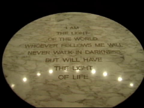 Light Of The World Jesus' words carved in the floor, two people walking across religious text stock videos & royalty-free footage