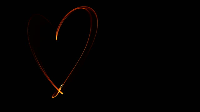 light painting heart love on black background for valentines day video