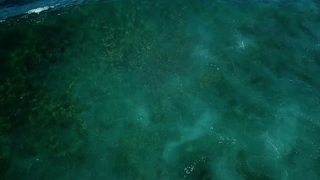 Light Penetrating Water's Surface as Seen by Drone in Hawaii video