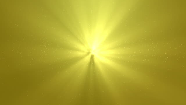 light rays with gold glitter particles background - luce gialla video stock e b–roll