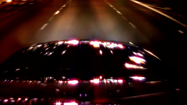 Light Reflections on Car Camera POV Car mounted camera POV of sparkling city lights reflecting off the hood of a car. luxury car stock videos & royalty-free footage