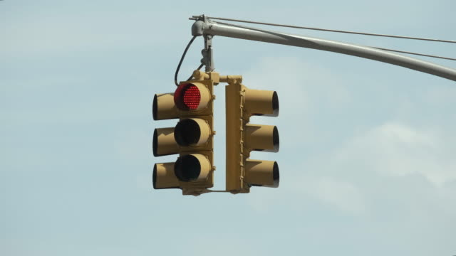 Light Traffic Works. Cloudy Sky Background. Traffic Regulation. Traffic Light Isolated. Beautiful Sky In The Background. stoplight stock videos & royalty-free footage