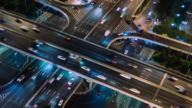 t/l ms ha pan light trail of beijing highway at night - città diffusa video stock e b–roll