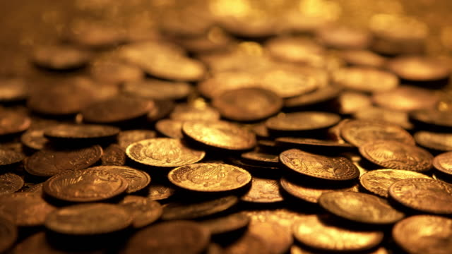 Light transition over gold coins Light transition over gold coins. gold bars stock videos & royalty-free footage