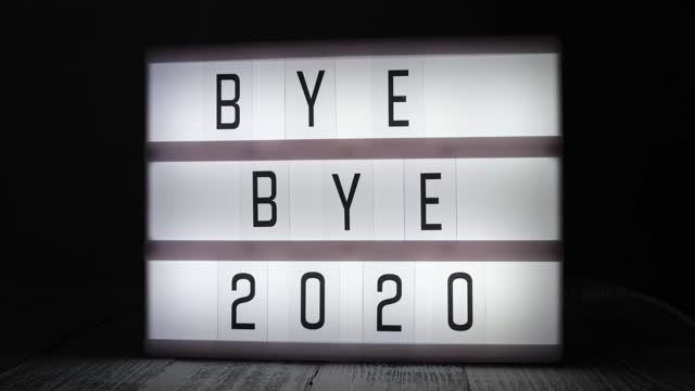 Lightbox with text BYE BYE 2020 in dark room. Hope, new life and Happy New Year 2021 concepts