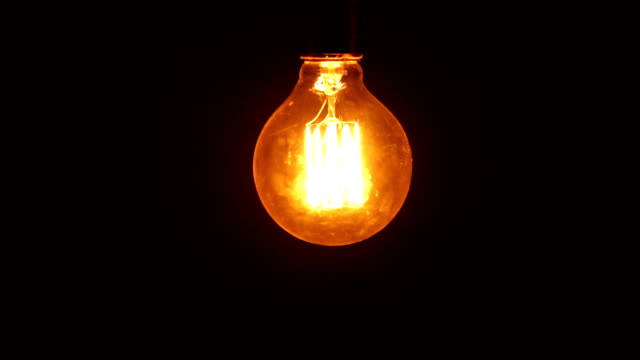 Lightbulb on black background - Idea concept video