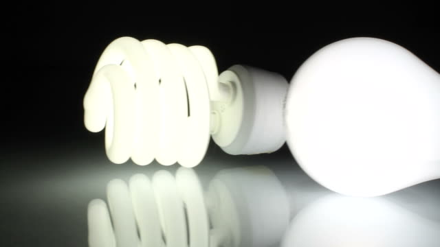 Lightbulbs Tracking Shot From Old to New Concept shot for new LED lightbulbs, which will replace incandescent and CFL bulbs soon. led light stock videos & royalty-free footage