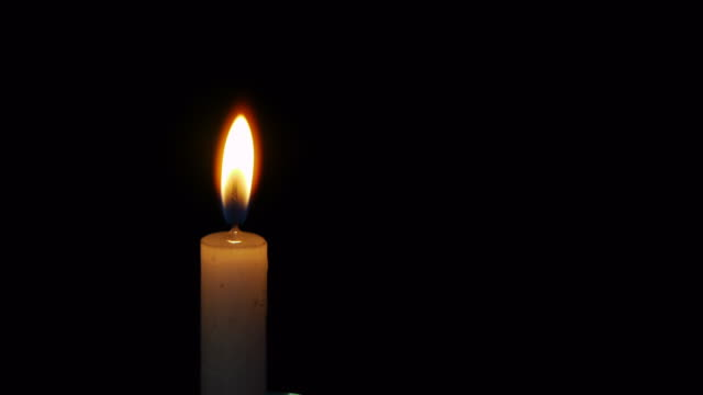 Lighted candles in the night