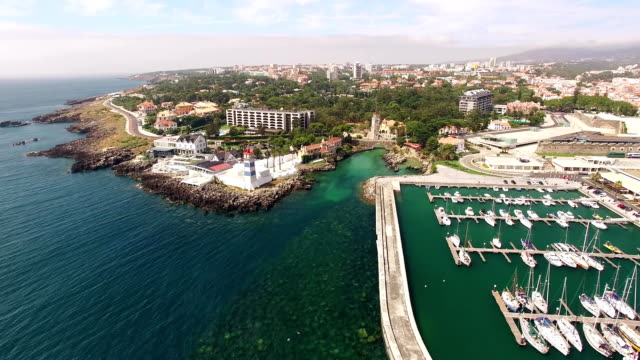 Lighthouse and marina of Cascais Portugal aerial view video