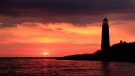 istock Lighthouse at sunset 833837990