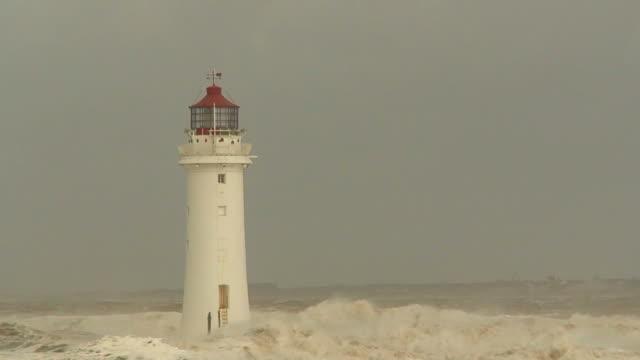 lighthouse in a huge storm - flod vatten brygga bildbanksvideor och videomaterial från bakom kulisserna