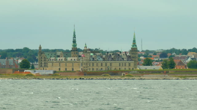 Bидео lighthouse in the old abbey on the coast of Denmark - view from the ship