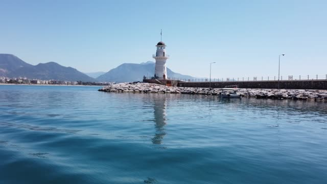 Lighthouse of Alanya Alanya is in Antalya, Turkey, situated on the south coast. jetty stock videos & royalty-free footage