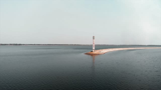 Lighthouse of water-power plant. Aerial drone view of lake with lighthouse