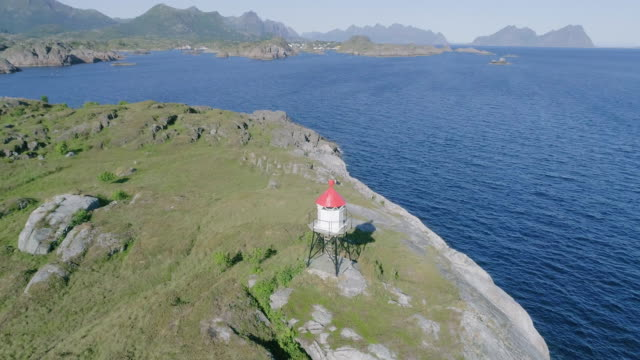 Lighthouse on island and beautiful sea nature Norway natural landscape aerial footage. 4K vacation travel concept.