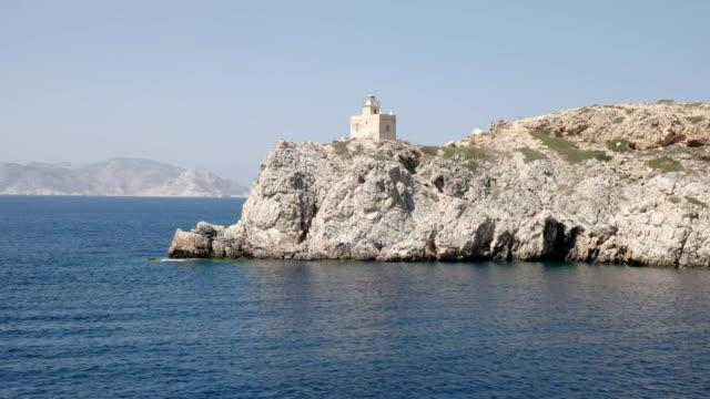 lighthouse ormos harbor on the island of ios, greece