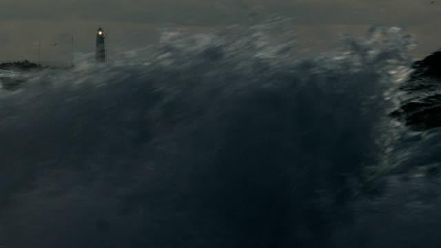 lighthouse through storm waves
