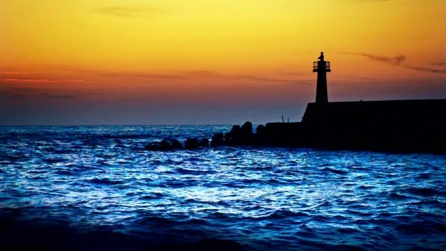 lighthouse under sunburst video