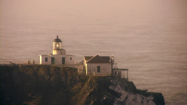 Lighthouse V.2 (HD) A lighthouse on the edge of a cliff. (1080i source) 笹 stock videos & royalty-free footage