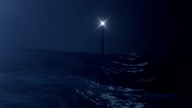 leuchtturm blick von einem stürmenden ozean - leuchtturm stock-videos und b-roll-filmmaterial