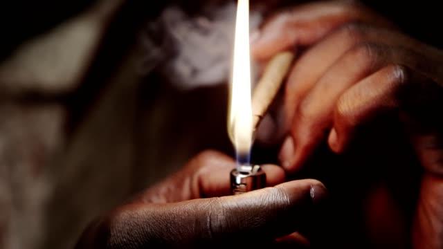 Lighting a marijuana blunt Lighting a marijuana blunt and smoking. marijuana stock videos & royalty-free footage