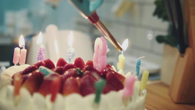 Lighting Candles on a Birthday Cake