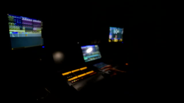 Lighting engineer works on a light console.