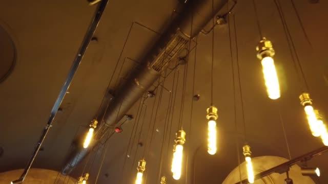 Lighting lamps in the pub. Interior of pub. video