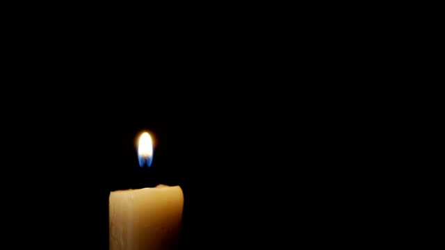 lighting the candle with match 1080p - mum aydınlatma ürünleri stok videoları ve detay görüntü çekimi