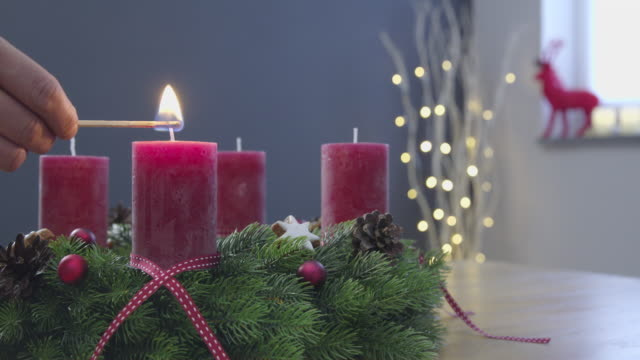 Lighting the candles of an advent wreath - sequence video