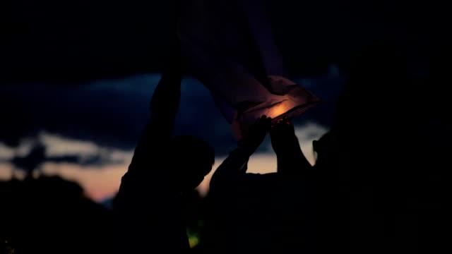 lighting the paper lantern - sky lantern stock videos and b-roll footage