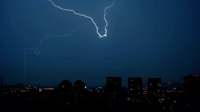lightning flashes over the city - fulmine video stock e b–roll