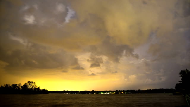 Lightning flashing in the clouds as a storm moves over the lake