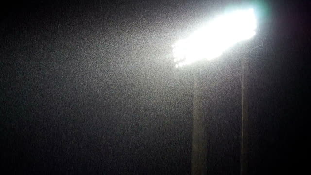 Lightning lights with heavy raining Footage of Lightning lights stand at night  during a heavy rain between football match, raining weather with fan cheer sound floodlight stock videos & royalty-free footage
