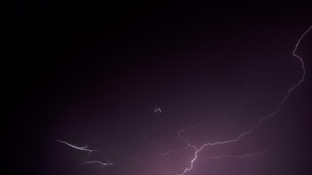 Lightning Night Single Lightning strike and bolt isolated on black background lightning stock videos & royalty-free footage