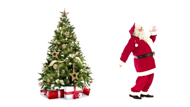 vídeos de stock e filmes b-roll de lights decorated xmas tree with gift boxes and santa claus happy dancing on white background with text space to place logo or copy.animated christmas present greeting post card video - christmas tree